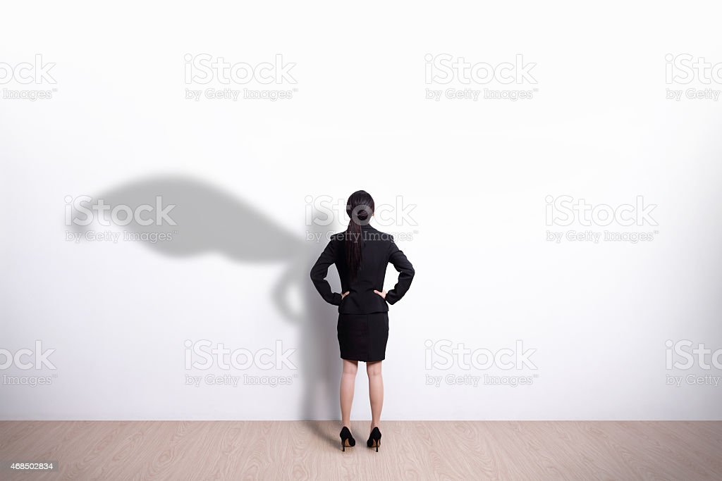 Superhero business woman looking stock photo