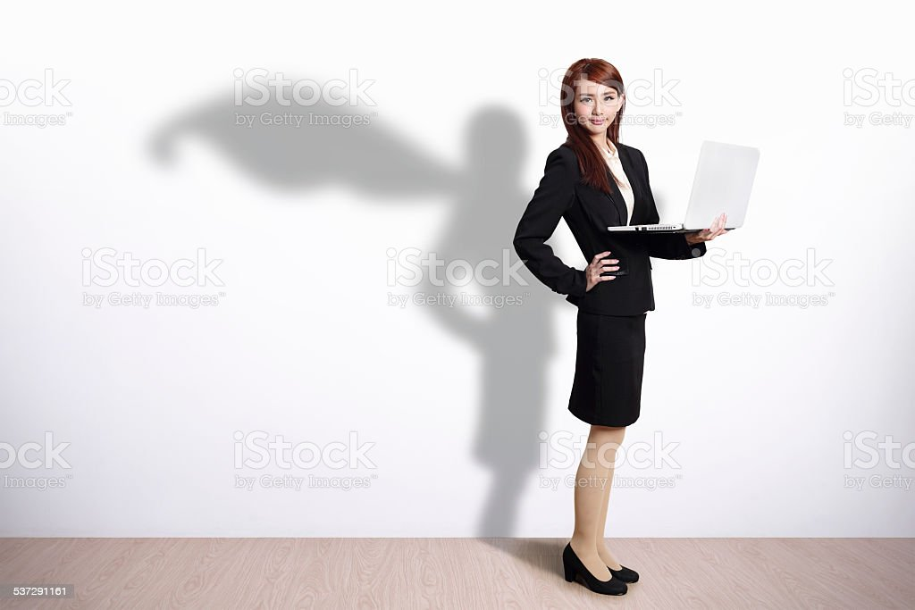 Superhero Business Woman with computer stock photo