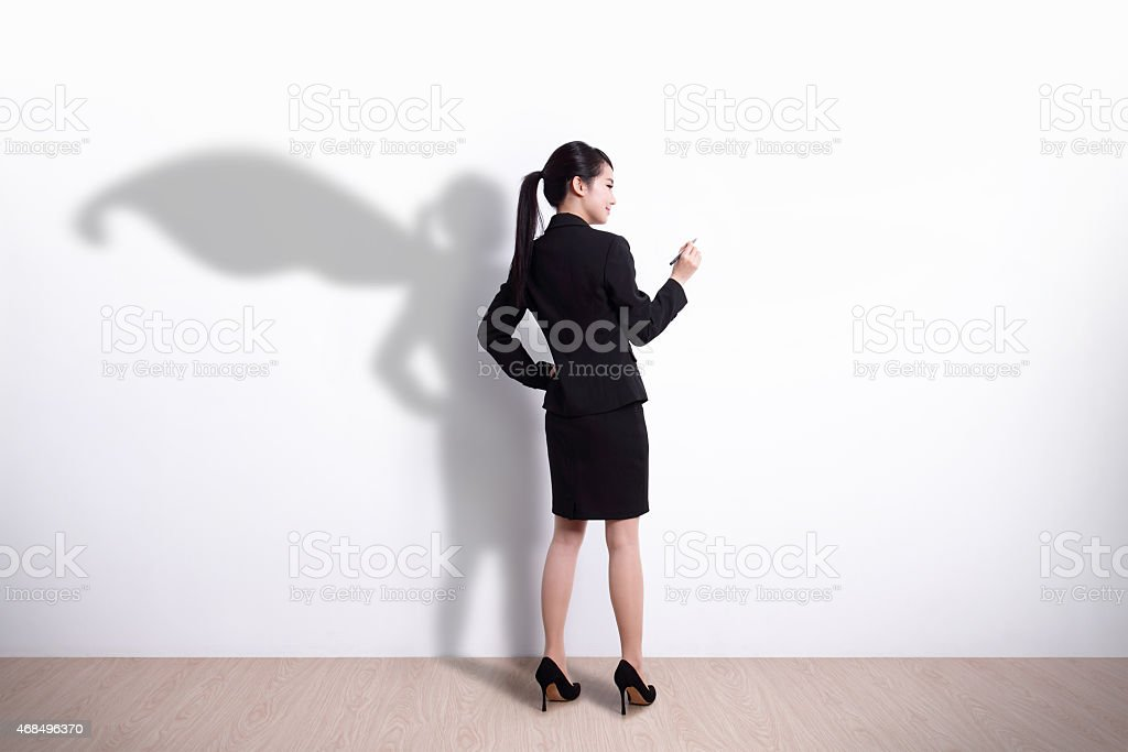 Superhero business woman writing stock photo