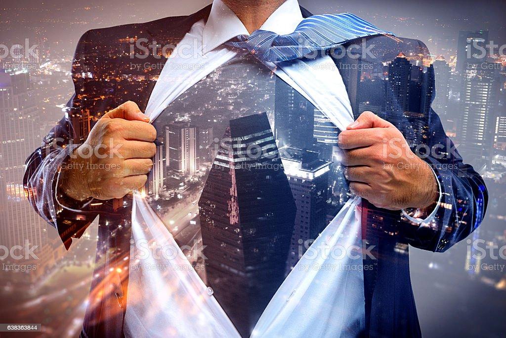 Superhero businessman double exposure with cityscape stock photo