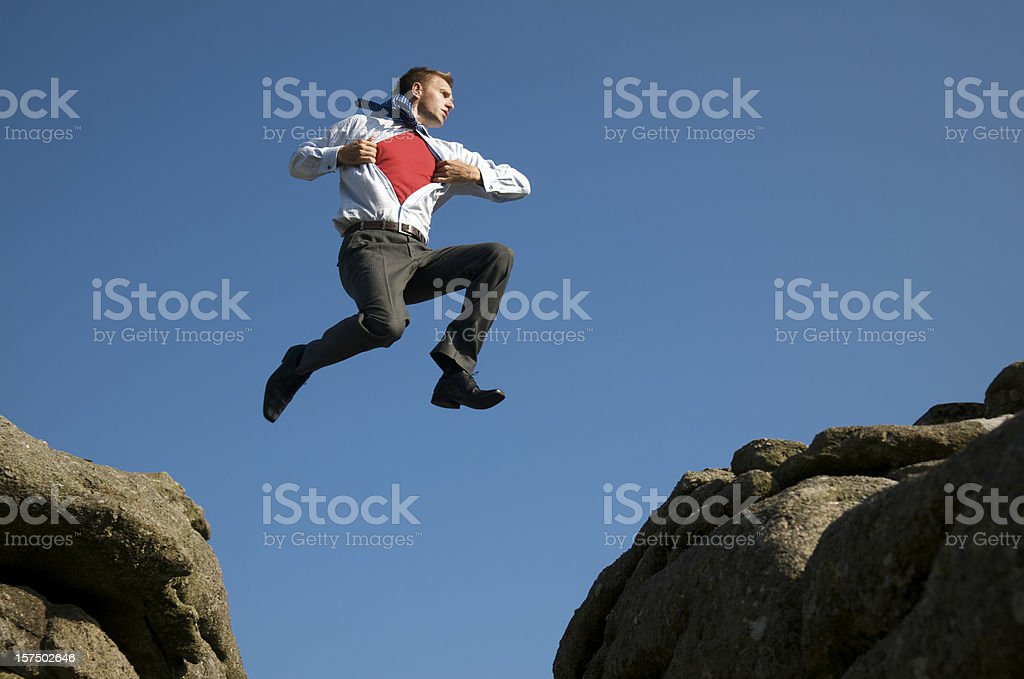 Superhero Businessman Leaps into the Sky royalty-free stock photo