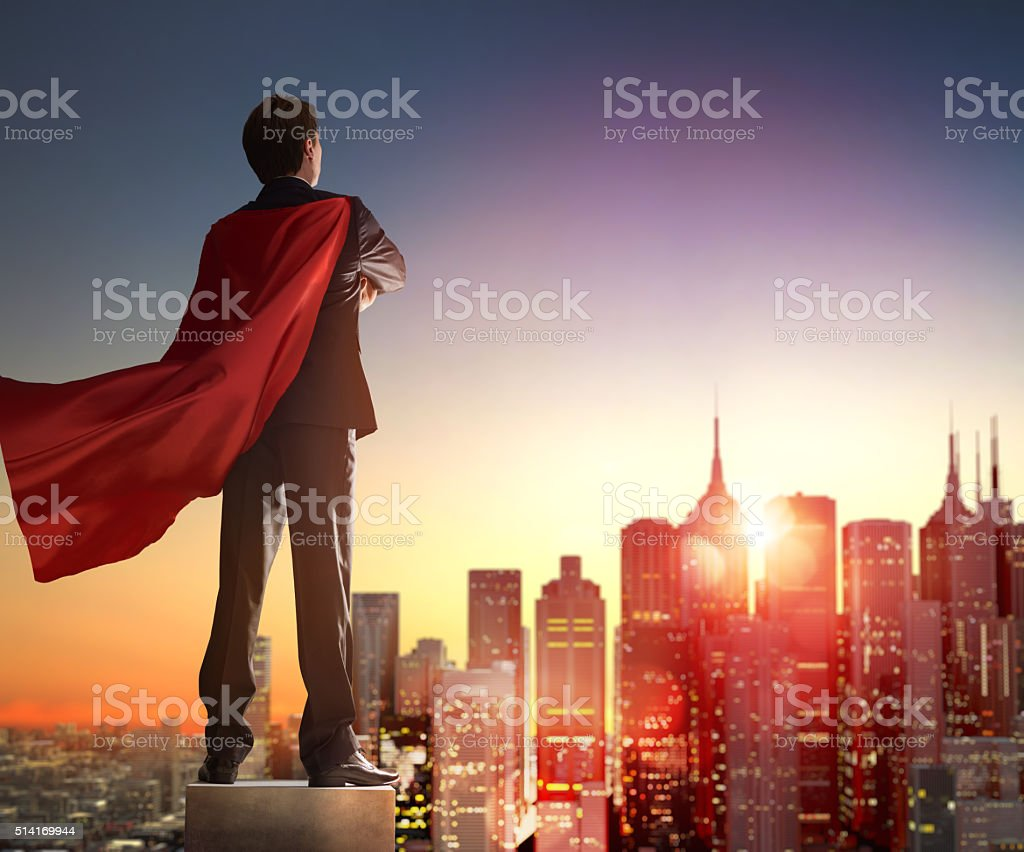 superhero businessman looking at city stock photo