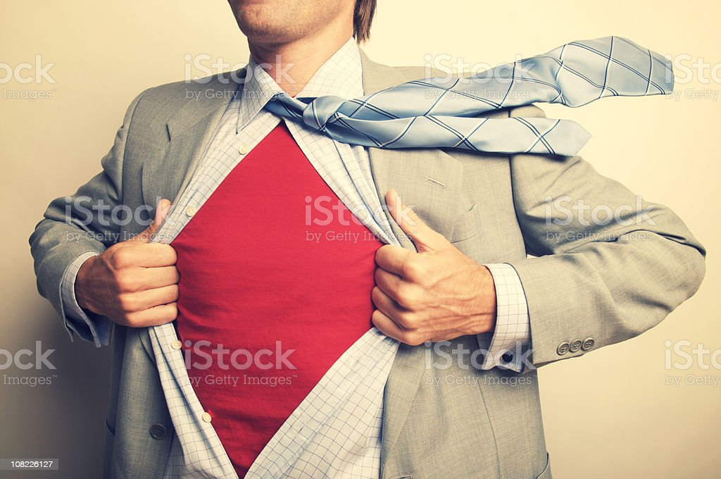 Superhero Businessman Office Worker Revealing Red Shirt Under Suit stock photo