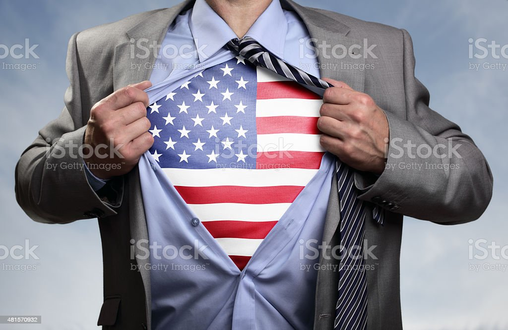 Superhero businessman revealing American flag stock photo