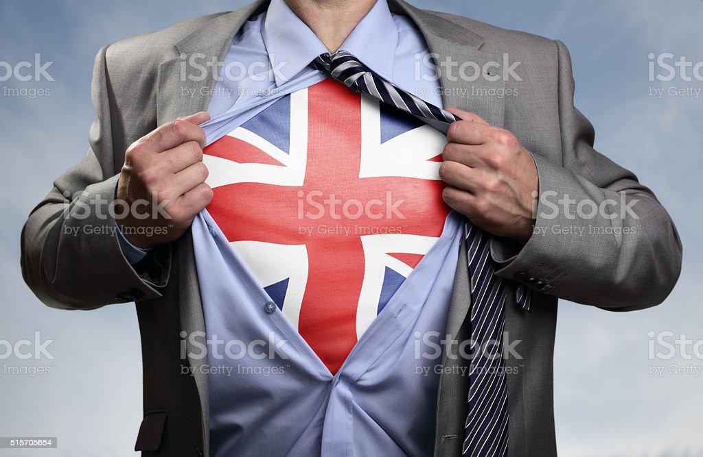 Superhero businessman revealing British flag stock photo