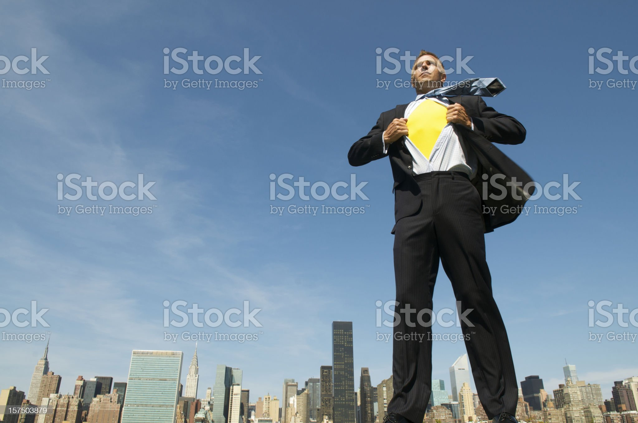Superhero Businessman Standing Tall Over City Skyline royalty-free stock photo