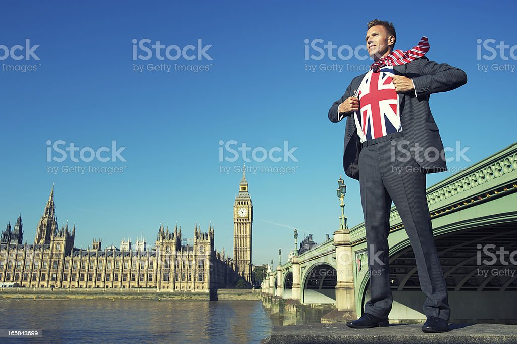 Superhero Businessman Stands at Houses of Parliament London stock photo