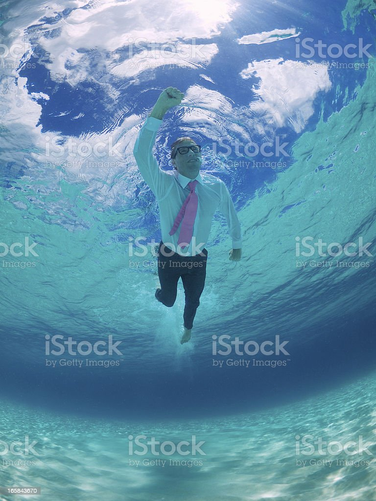 Superhero Businessman Swims Underwater Blue Sky royalty-free stock photo
