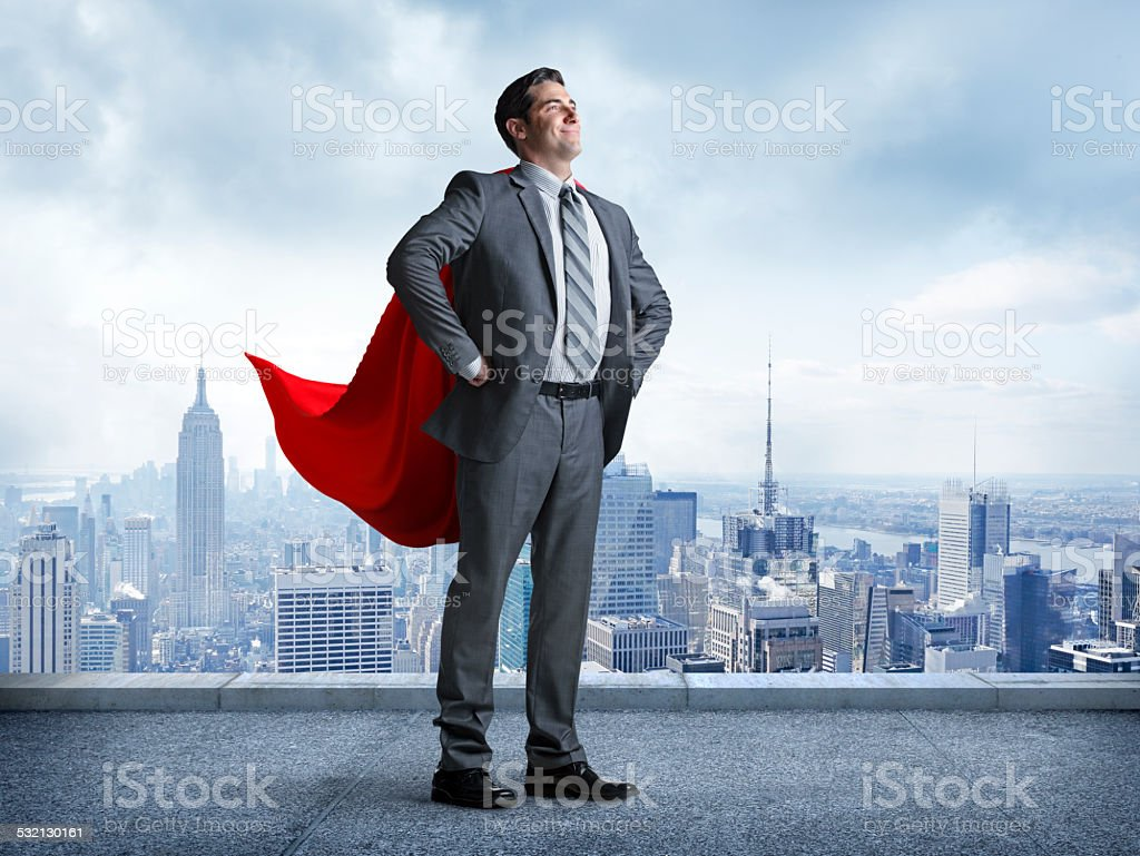Superhero Businessman With Cityscape In The Background stock photo
