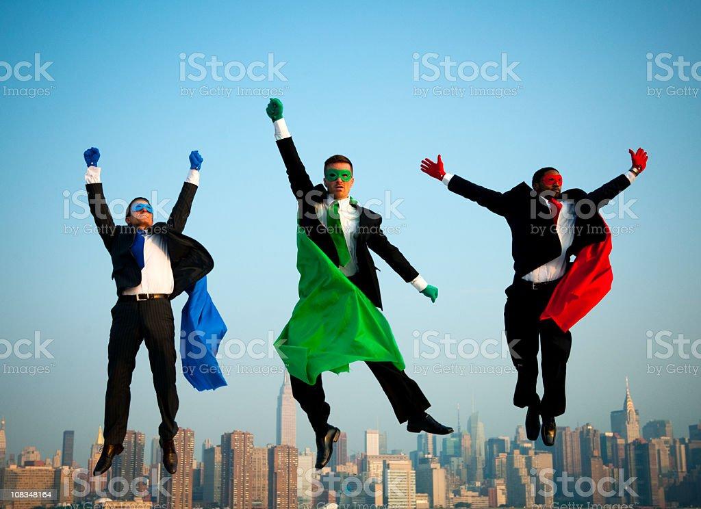 Superhero Businessmen flying over Manhattan royalty-free stock photo