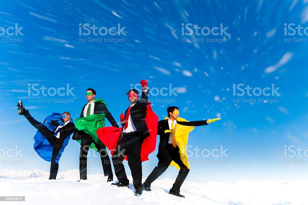 Superhero Businessmen on a Winters Mountain Peak royalty-free stock photo