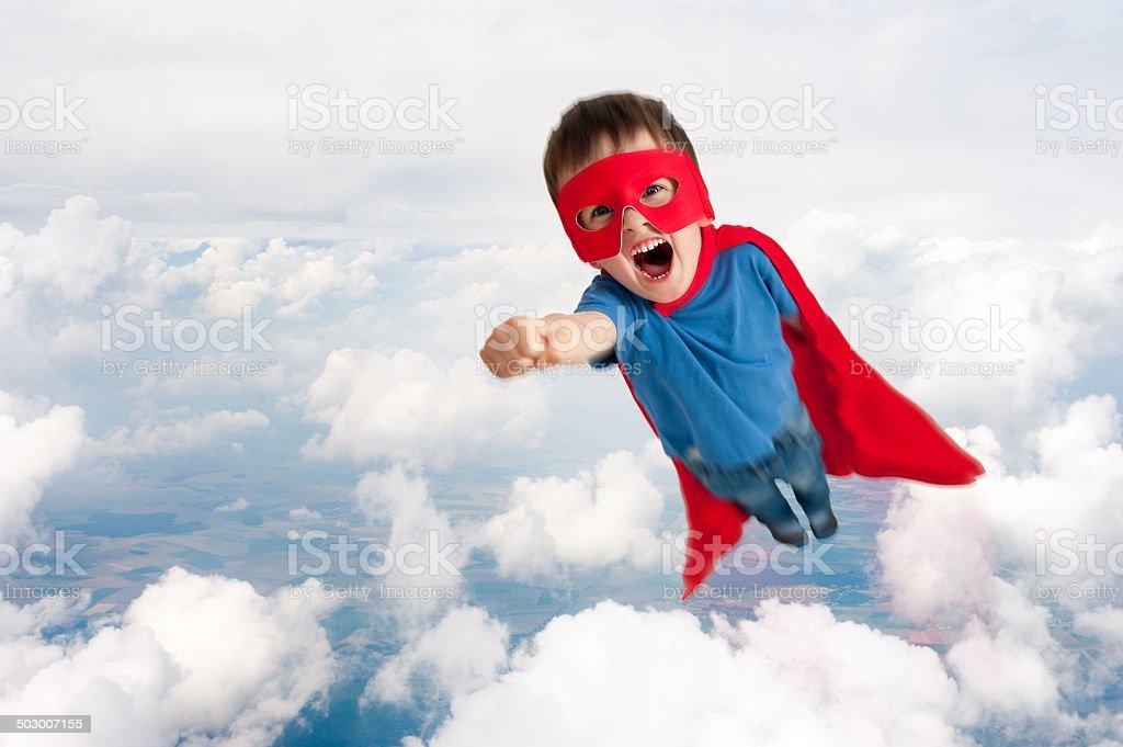 superhero child boy flying stock photo