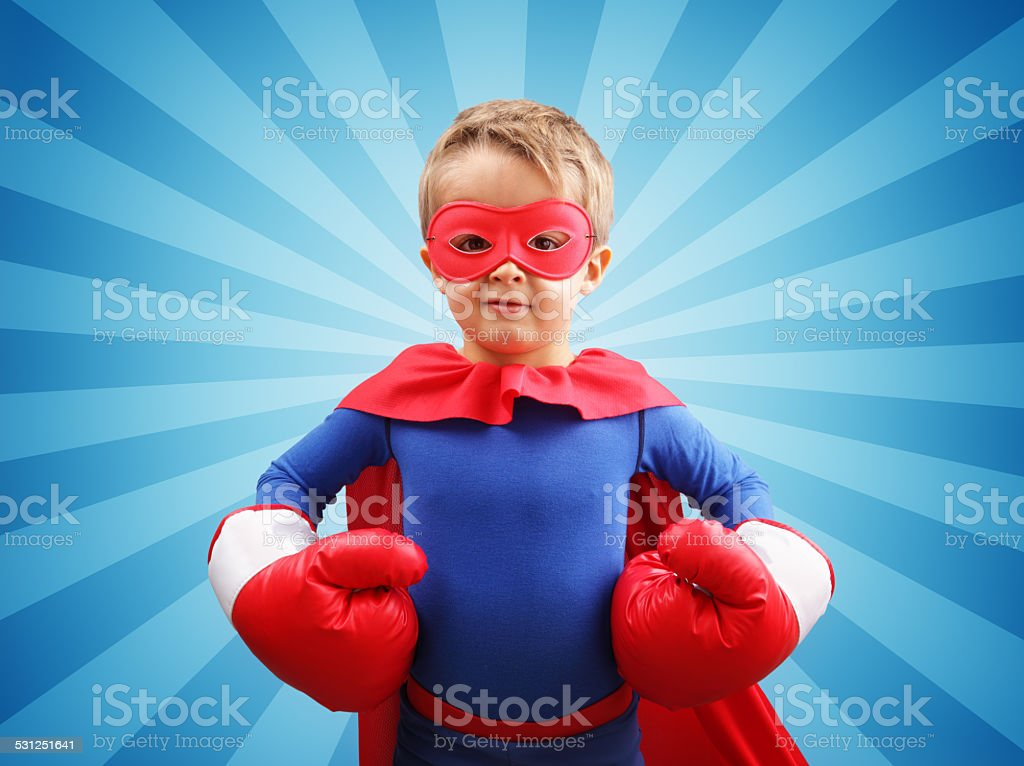 Superhero child with boxing gloves stock photo