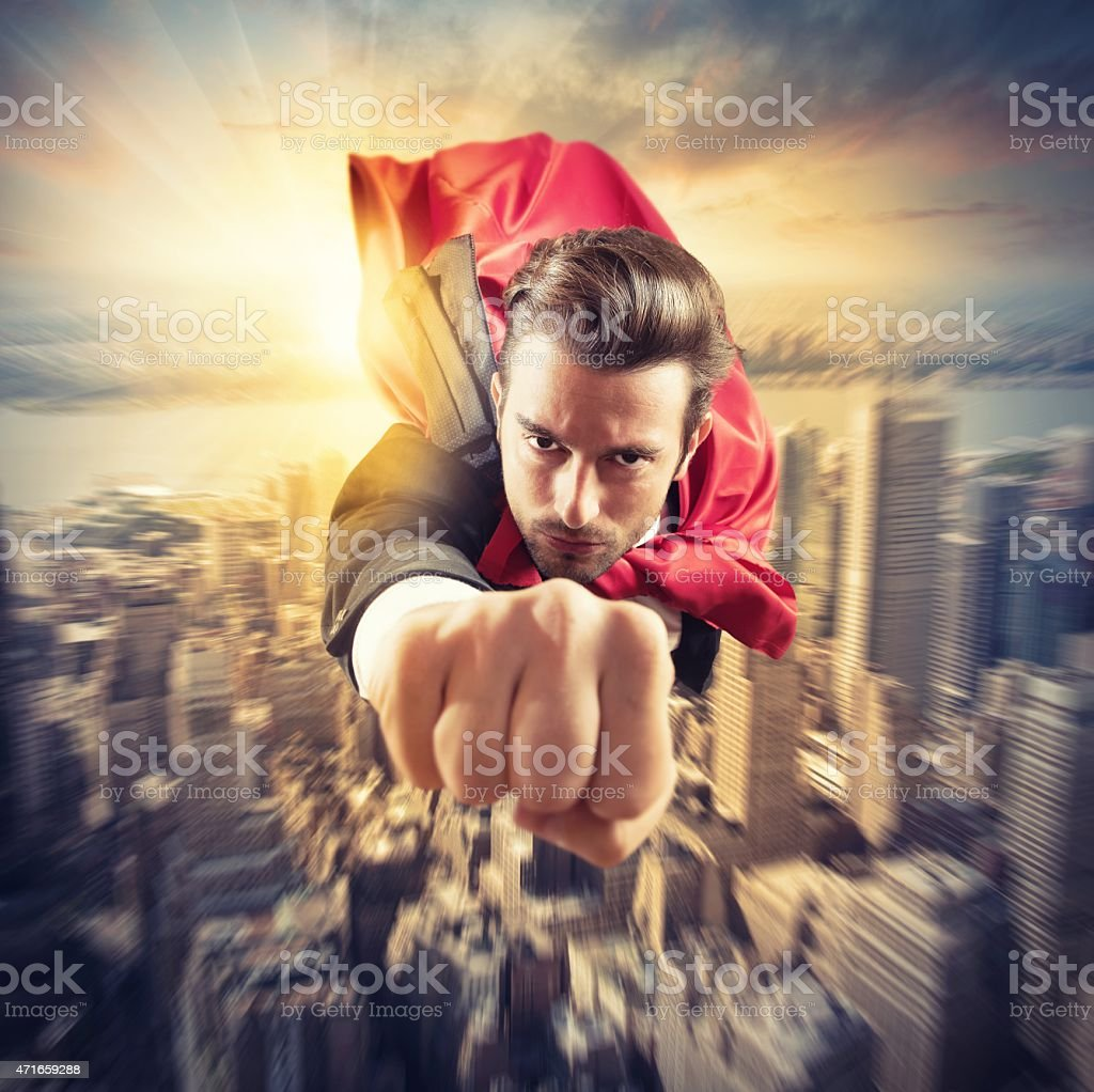 Superhero flies faster stock photo