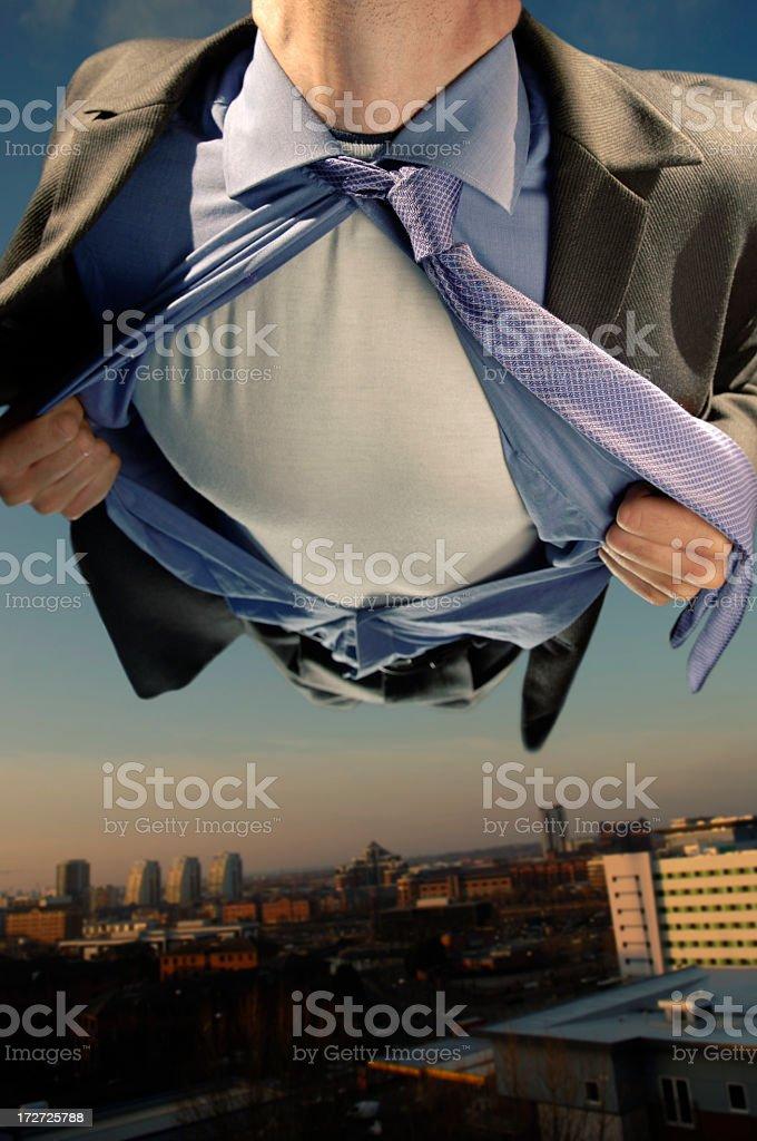 Superhero Flying Over City Buildings stock photo