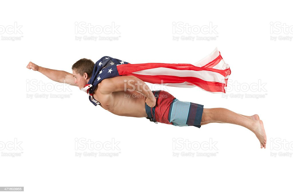 Superhero flying with cape of American flag royalty-free stock photo