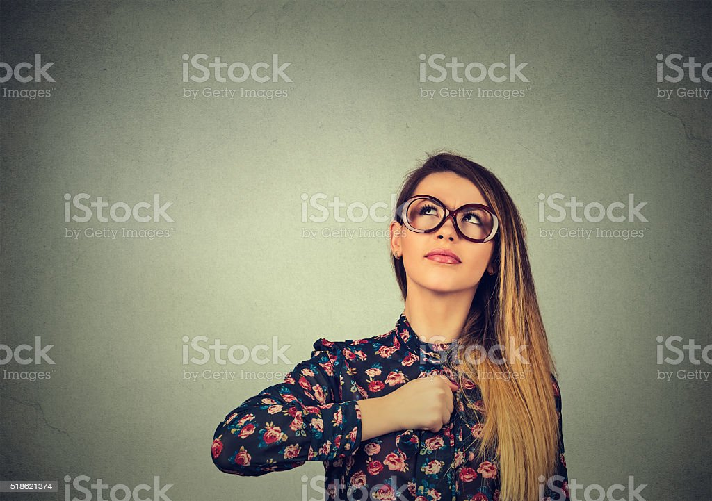 Superhero girl. Confident woman in glasses. stock photo