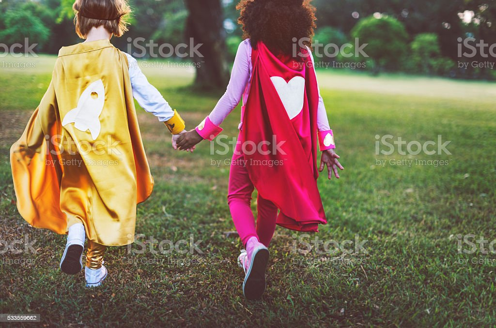 Superhero Girls Friendship Cute Happiness Fun Playful Concept stock photo