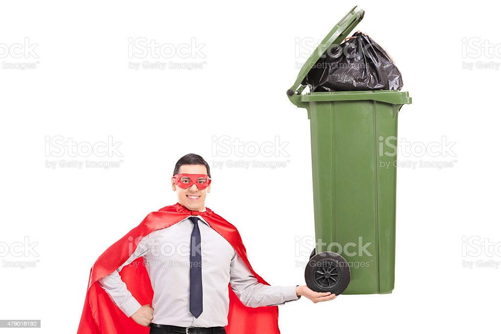 Superhero holding a large trash can isolated on white stock photo