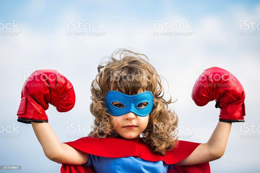 Superhero kid. Girl power concept stock photo