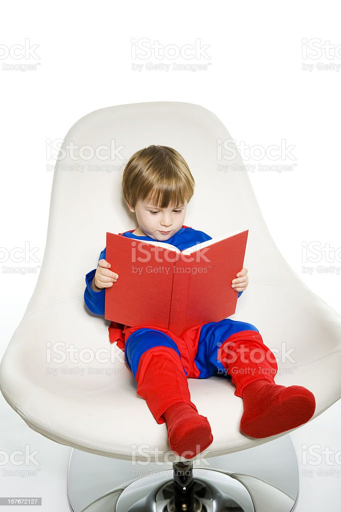 Superhero Kid Reading royalty-free stock photo