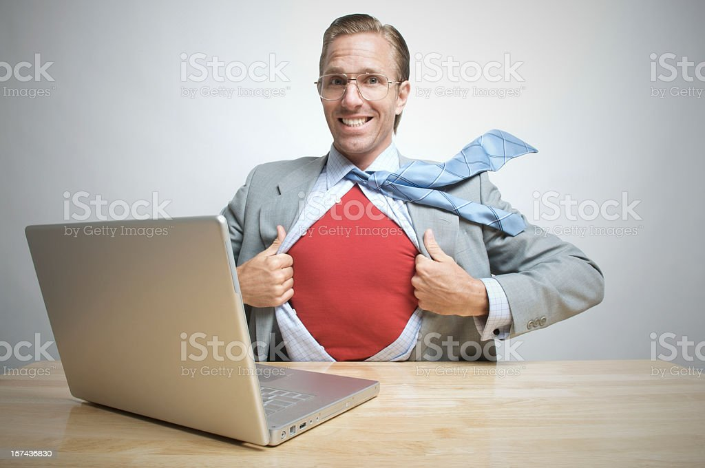 Superhero Office Worker Businessman Smiles Sitting at Desk Red Shirt royalty-free stock photo