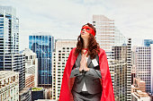 Superhero praying outdoors