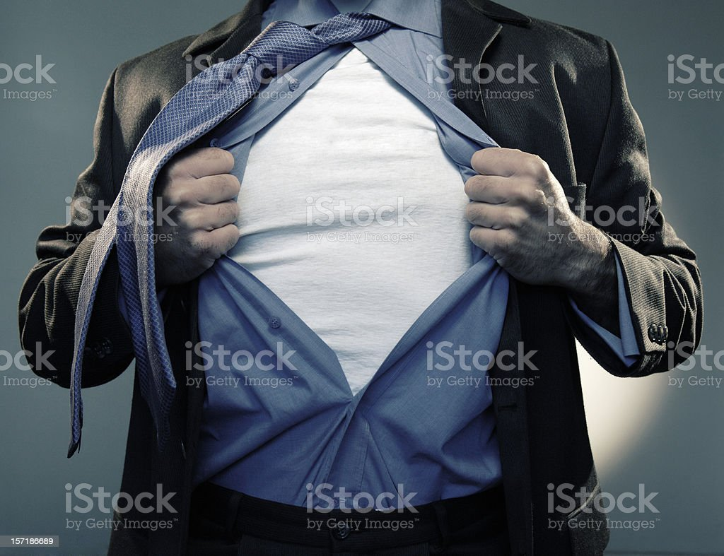 Superhero Pulling Open Shirt in Mid Air stock photo