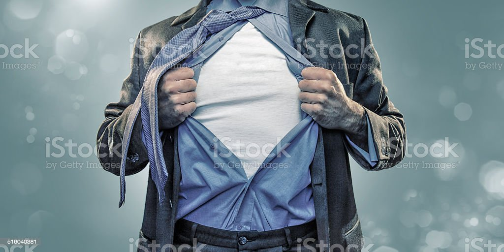 Superhero Pulling Open Shirt stock photo
