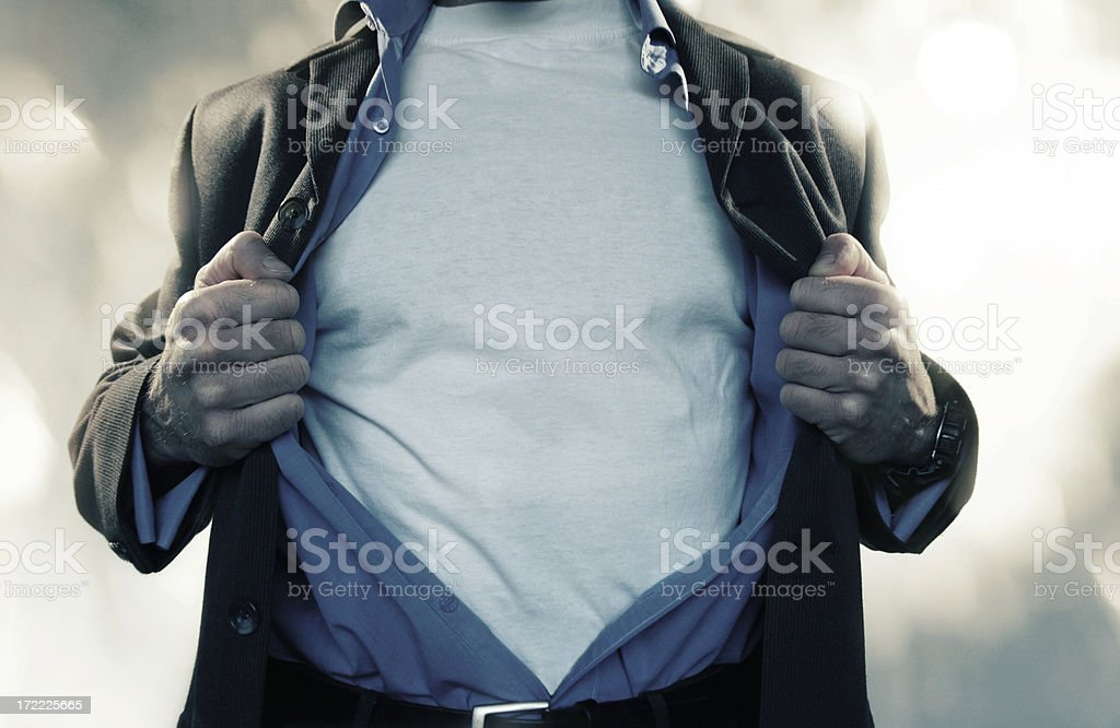 Superhero Pulling Shirt Open royalty-free stock photo