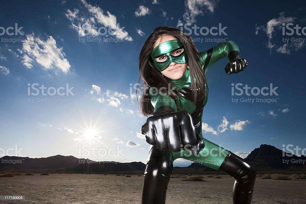 Superhero Punch by Masked Ethnic Female royalty-free stock photo