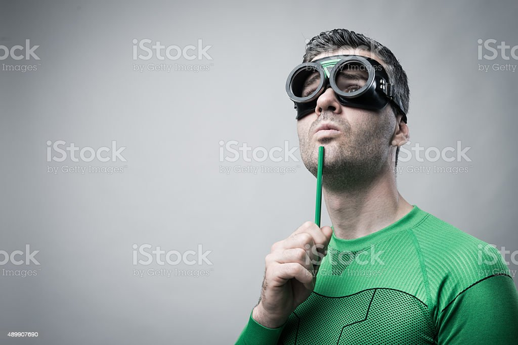 Superhero thinking with green pencil stock photo