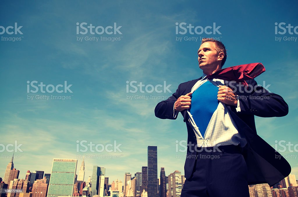 Superhero Young Man Businessman Standing Outdoors Over City Skyline stock photo