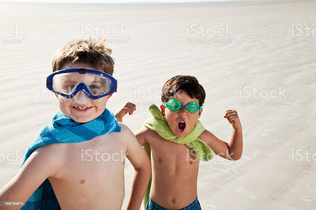 Superheroes at the beach royalty-free stock photo