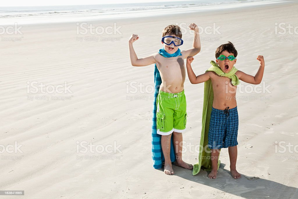 Superheroes at the beach stock photo