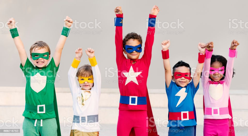 Superheroes Cheerful Kids Expressing Positivity Concept stock photo