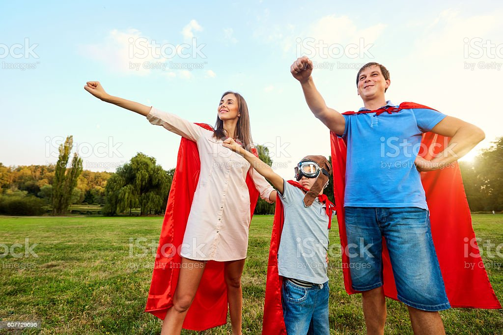 Superheroes family. Mother, father and son  costumes stock photo