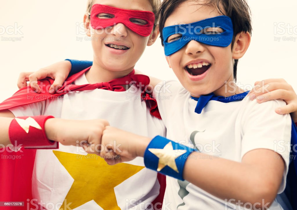 Superheroes Friends Fist Bump Happiness Concept stock photo