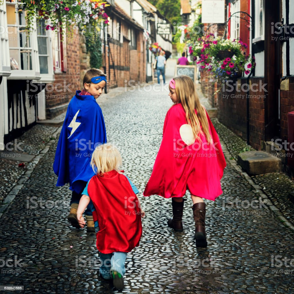 Superheroes Kids Costume Imagination Learning Concept stock photo