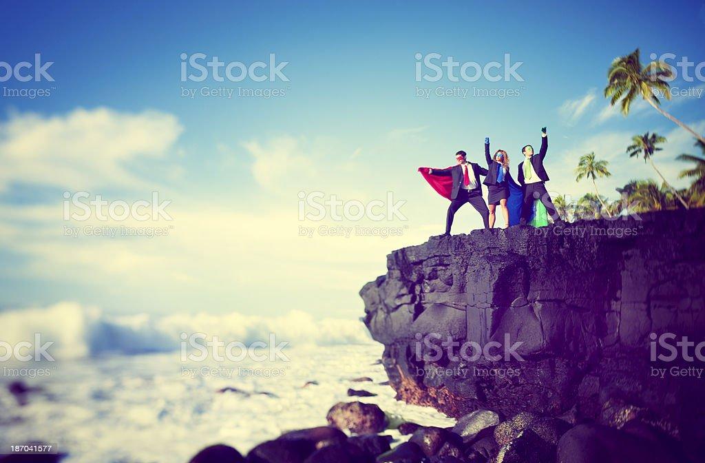 Superheroes on edge of cliff stock photo