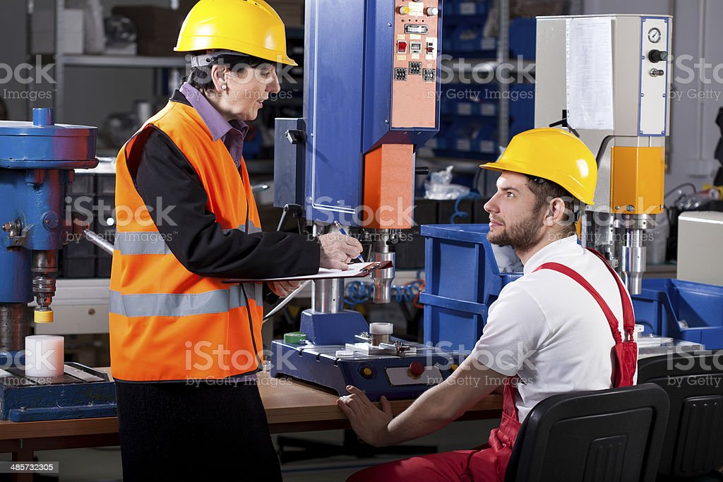 Superior and worker in warehouse stock photo