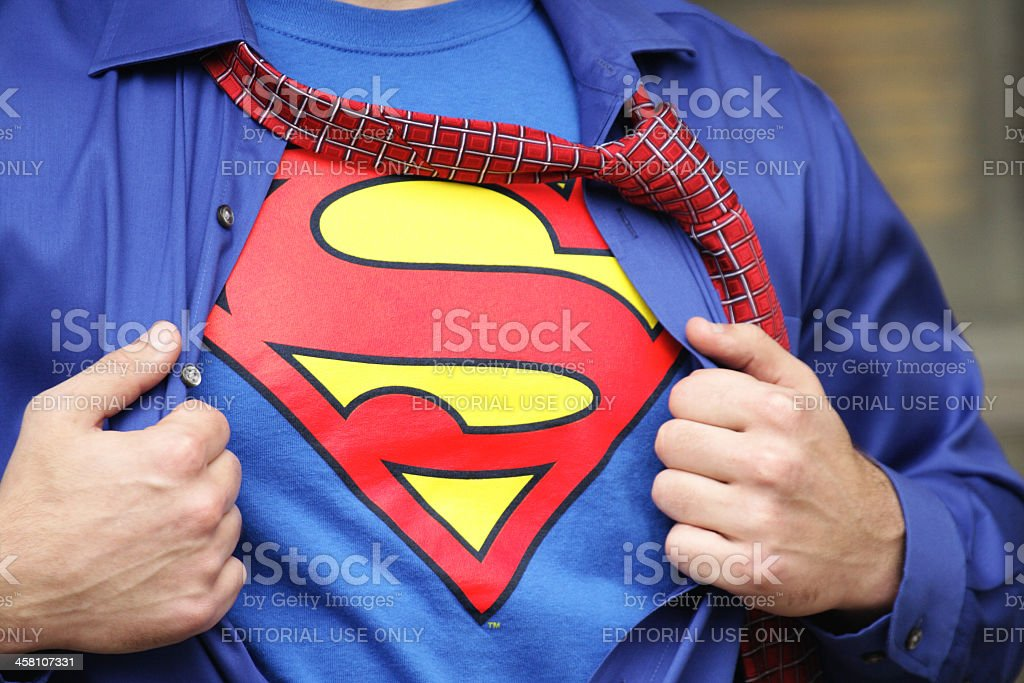 Superman Costume on Strong Young Man royalty-free stock photo