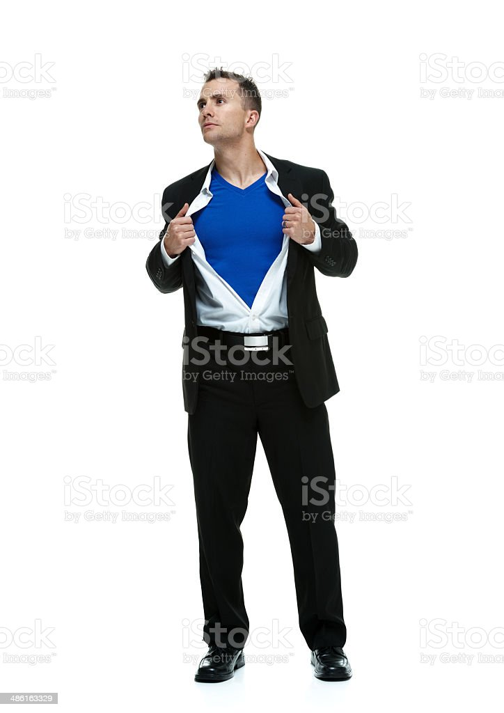 Superman holding shirt and looking away stock photo