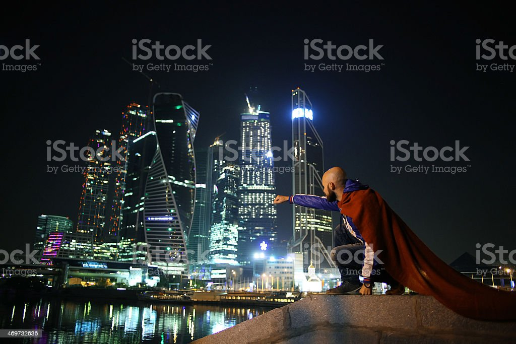 Superman in the night lights of the skyscrapers stock photo