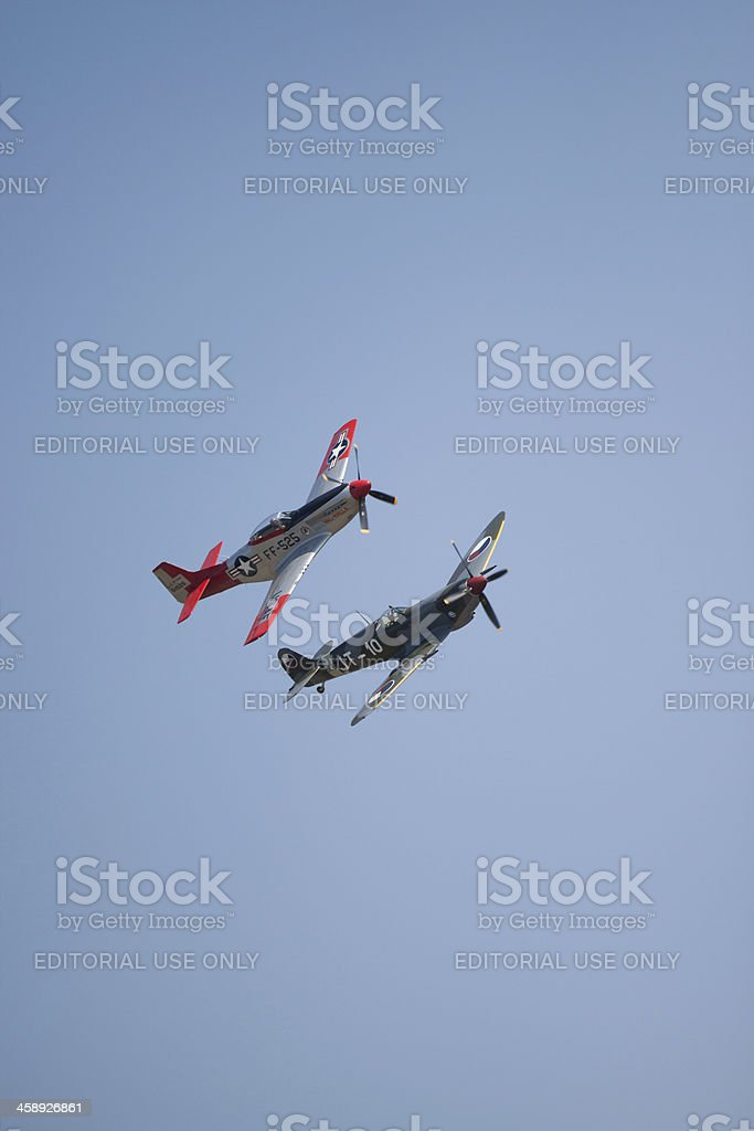 Supermarine Spitfire & P-51 Mustang Fighters In Flight stock photo