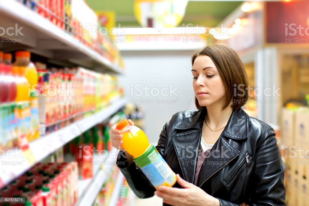 supermarket buying a bottle of juice stock photo