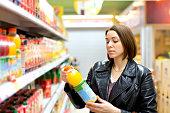 supermarket buying a bottle of juice