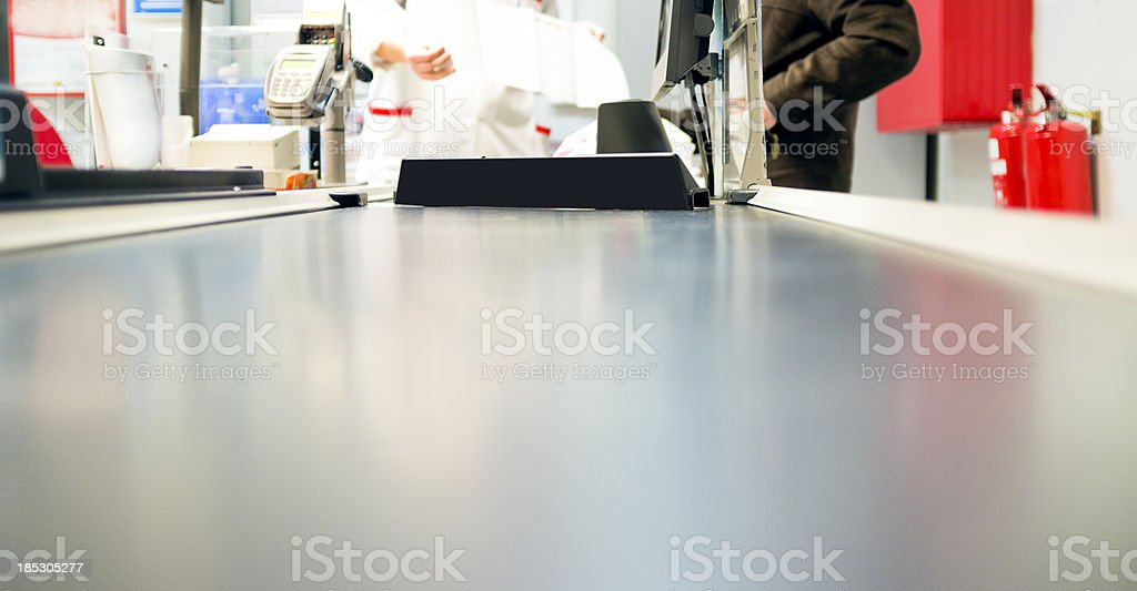 Supermarket checkout counter stock photo