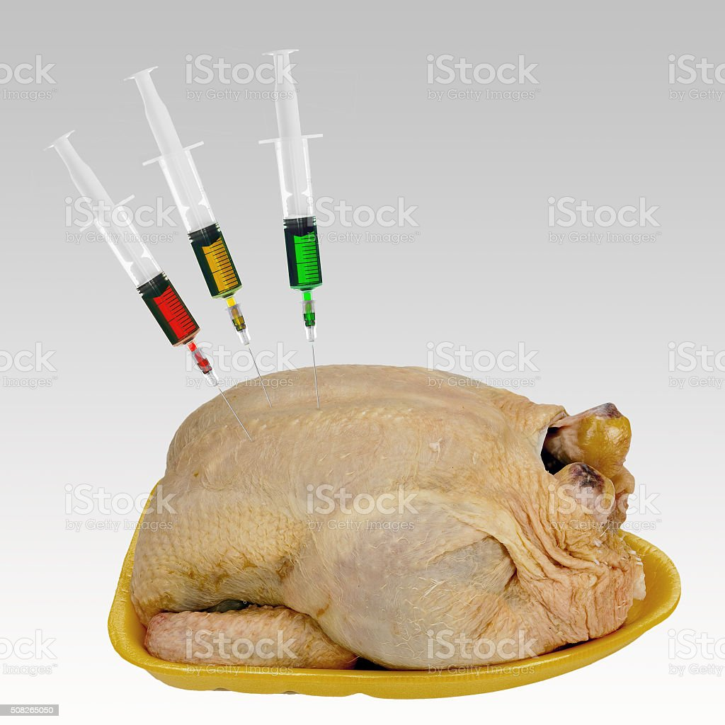 Supermarket chicken. Cheap food, mass produced. Concept. stock photo