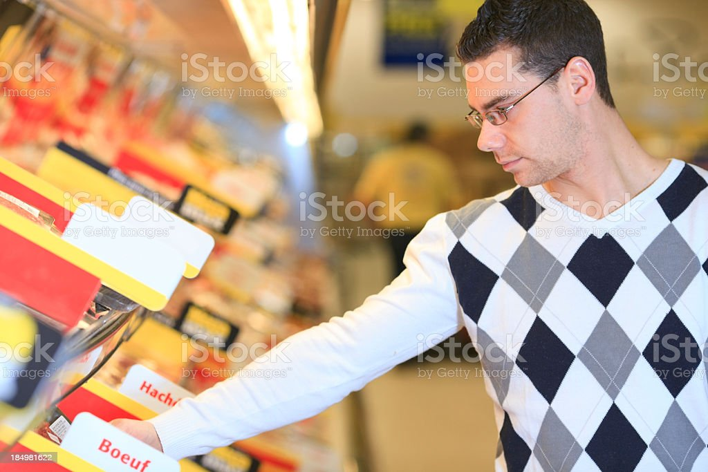 Supermarket Client - Meat Choosing royalty-free stock photo